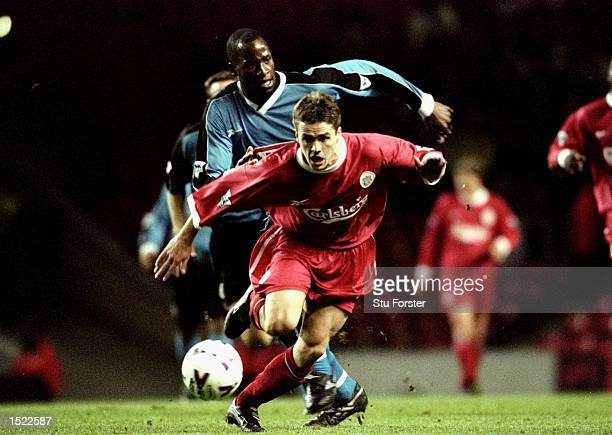 Michael Owen of Liverpool beats Ugo Ehiogu of Aston Villa during the FA Carling Premiership match at Anfield in Liverpool England The match was drawn...