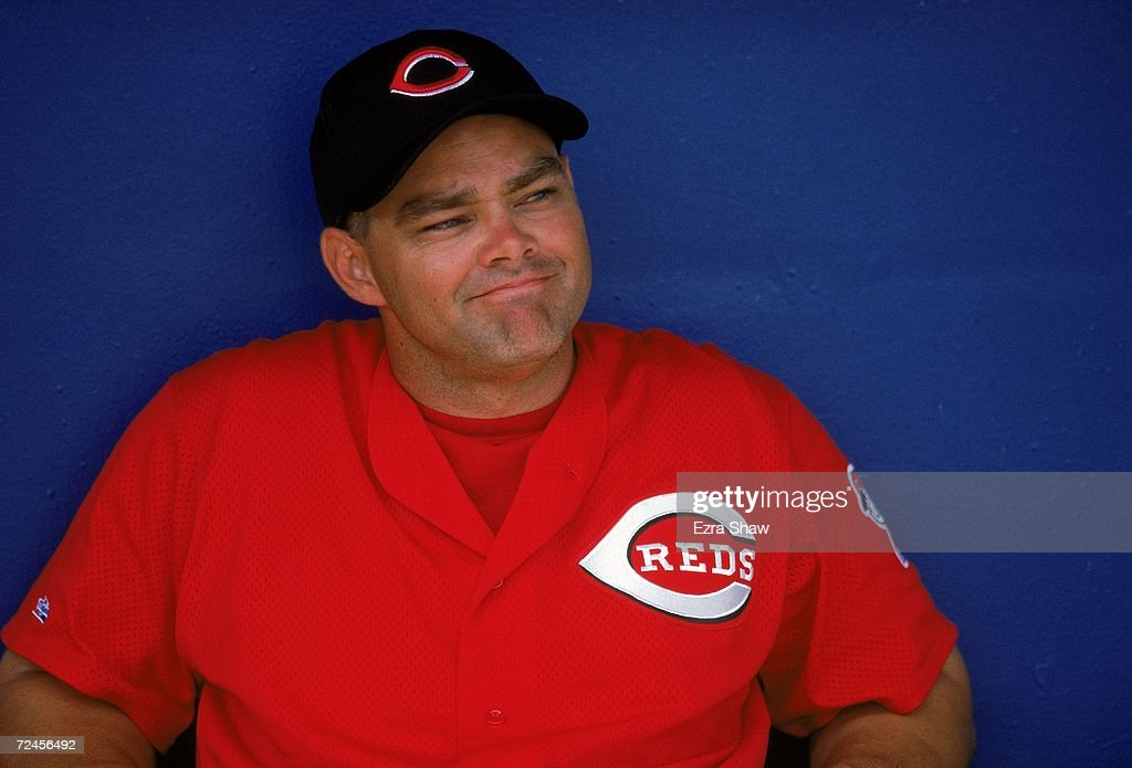 Outfielder Dante Bichette #9 of the Cincinnati Reds smiles as he watches from the dugout during the Spring Training Game against the Texas Rangers at Charlotte County Stadium in Port Charlotte, Florida. Mandatory Credit: Ezra O. Shaw/Allsport
