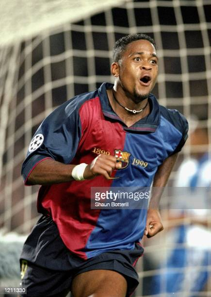 Patrick Kluivert celebrates a goal for Barcelona against Porto during the UEFA Champions League group A match at the Nou Camp in Barcelona Spain...