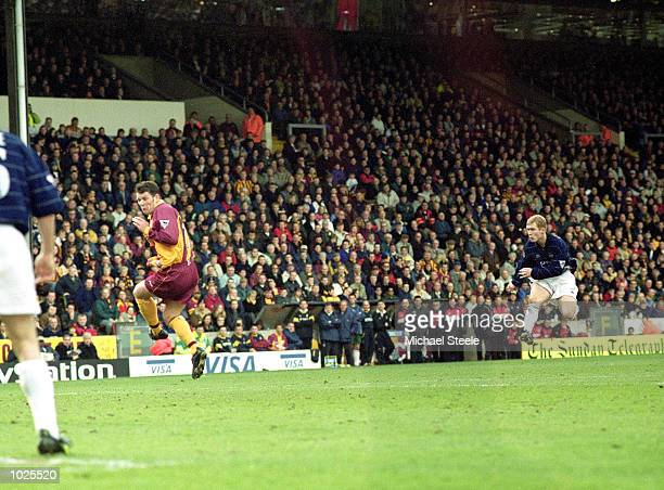 Paul Scholes of Manchester United volleys home the third goal during the FA Carling Premiership match against Bradford City at Valley Parade in...