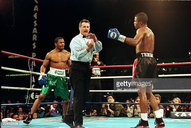 Referee Mitch Halpern gives a signal to Felix Trinidad during the fight against David Reid at Caesar Palace in Las Vegas Nevada Trinidad defeated...