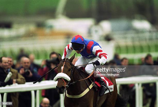 Richard Johnson and Looks Like Trouble on their way to victory in the Cheltenham Gold Cup Steeple Chase at the Cheltenham National Hunt Festival at...