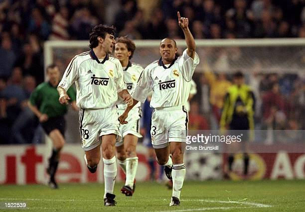 Roberto Carlos of Real Madrid holds his arm aloft in celebration during the UEFA Champions League match against Dynamo Kiev at the Bernabeu Stadium...