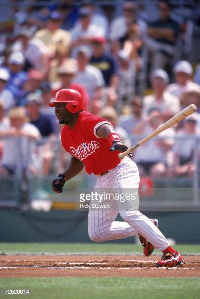 Ron Gant of the Philadelphia Phillies drops the bat to run during the Spring Training Game against the Detroit Tigers at Jack Russell Memorial...