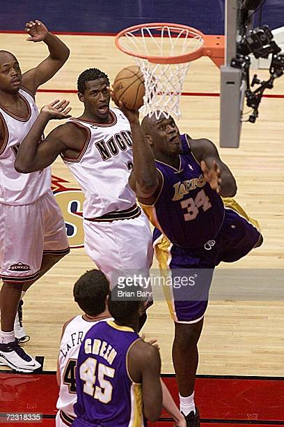 Shaquille O''Neal of the Los Angeles Lakers drives to the basket against Nick Van Exel and Antonio McDyess of the Denver Nuggets in the first half at...