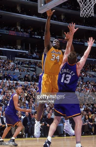 mar-2000-shaquille-oneal-of-the-los-angeles-lakers-leaps-for-the-as-picture-id72361807?s=594x594