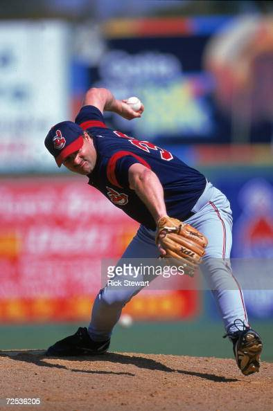 Steve Reed of the Cleveland Indians winds back to pitch the ball during the Spring Training Game against the Philadelphia Phillies at the Jack...