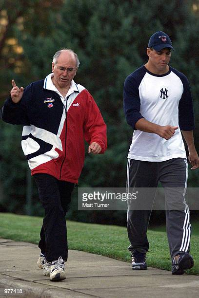 Australian Prime Minister John Howard on his morning walk with NRL Player Trent Barrett in Canberra Australia Mandatory Credit Matt Turner/ALLSPORT
