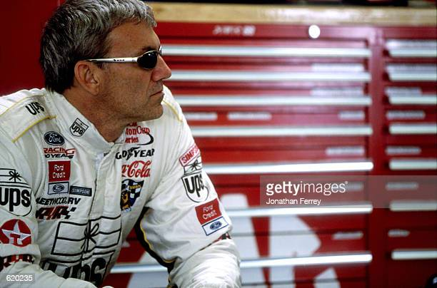Dale Jarrett who drives the Ford Taurus for Robert Yates Racing looks on during the UAWDaimler Chrysler 400 at the Las Vegas Motor Speedway in Las...