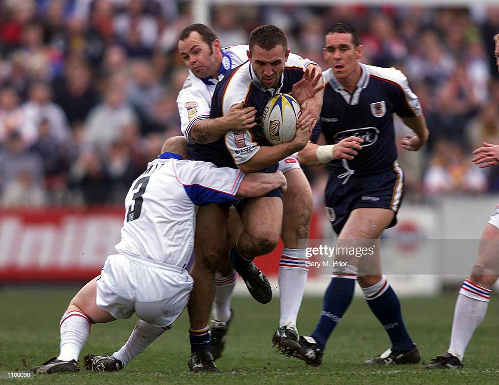 Daniel Gartner of Bradford Bulls is tackled by Richard Smith of Wakefield Wildcats during the Silk Cut Challenge Cup quarter final match between...