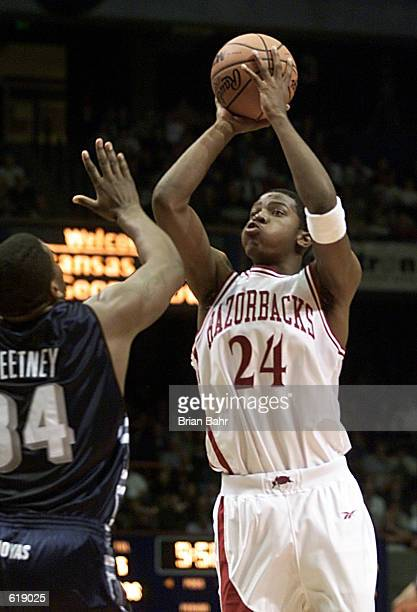 Guard Joe Johnson of the Arkansas Razorbacks shoots the ball as forward Mike Sweetney of the Georgetown Hoyas tries to get in his line of sight...