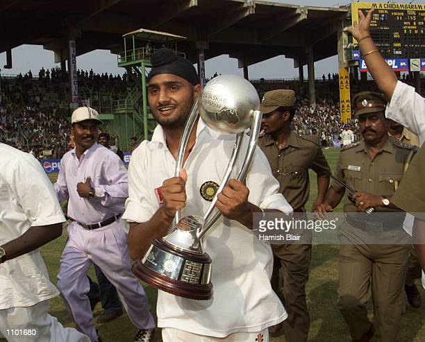 Harbhajan Singh of India runs with the trophy during a lap of honour after India won the series during day five of the third test between India and...