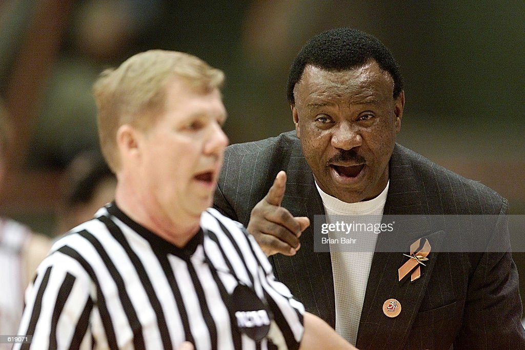 Head coach Nolan Richardson of the Arkansas Razorbacks admonishes an official to be certain of a courtside review after the Georgetown Hoyas scored...