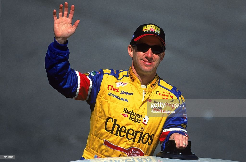John Andretti who drives a Dodge Intrepid for Petty Enterprises waves to his fans during the Food City 500 part of the NASCAR Winston Cup Series at...