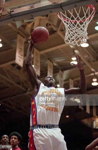Kwame Brown of the East moves up for the basket during the McDonalds High School All American Game against the West at the Cameron Indoor Stadium in...