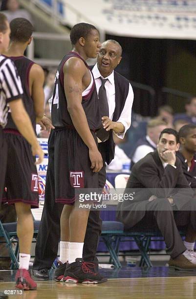 Lynn Greer of Temple listens to coach John Chaney coach during their NCAA South Region Final loss to Michigan State 6962 at the Georgia Dome in...