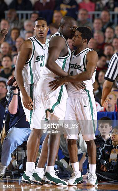 Marcus Taylor and Zach Randolph of Michigan State congratulate each other during the semifinal of the Men's NCAA Basketball Final Four tournament...