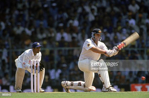 Matthew Hayden of Australia plays a sweep shot during his first innings score of 203 during the Third Test match against India played at the...
