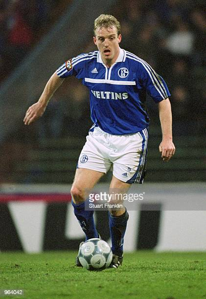 Michael Buskens of FC Schalke 04 runs with the ball during the German Bundesliga match against Hamburg played at Parkstadion in Gelsenkirchen Germany...