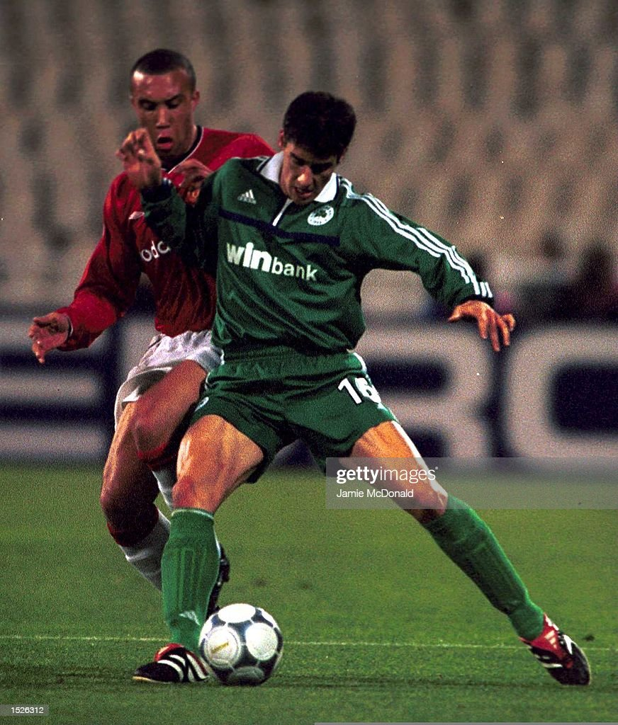 Mikael Silvestre of Manchester United battles for the ball with Giorgios Seitaridis of Panathinaikos during the match between Panathinaikos and...