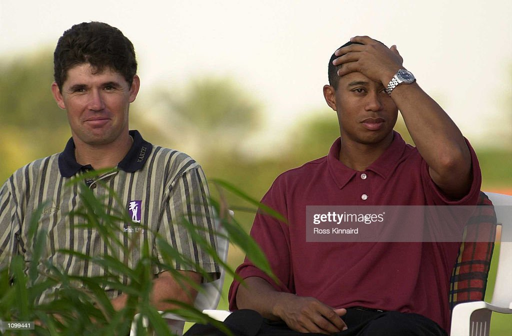 Padraig Harrington of Ireland and Tiger Woods of the United States after the final round of the Dubai Desert Classic in Dubai . Digital Image. Mandatory Credit: Ross Kinnaird/ALLSPORT