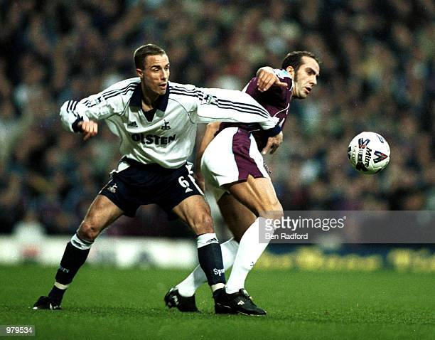 Paolo Di Canio of West Ham holds off Chris Perry of Spurs during the West Ham United v Tottenham Hotspur match in the AXA sponsored FA Cup Sixth...
