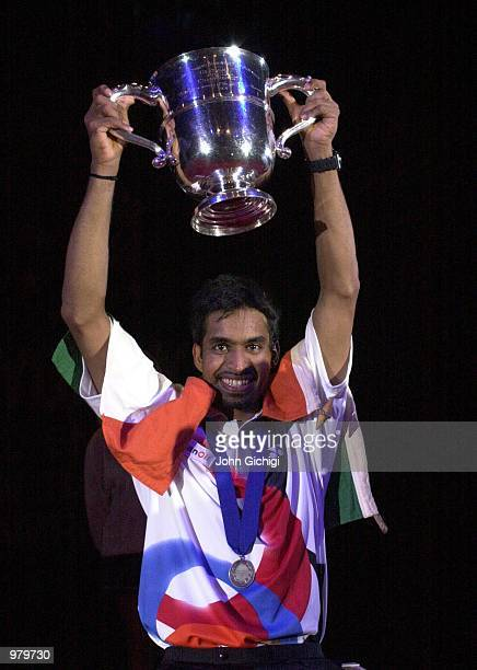 Pullela Gopichand of India celebrates with the trophy after winning the Mens Singles title at the Yonex All England Championships in Birmingham...