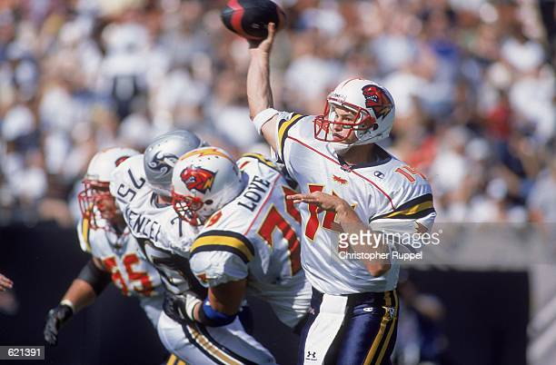 Quarterback Brian Kuklick of the Orlando Rage passes the ball during the game against the Los Angeles Xtreme at the Los Angeles Coliseum in Los...