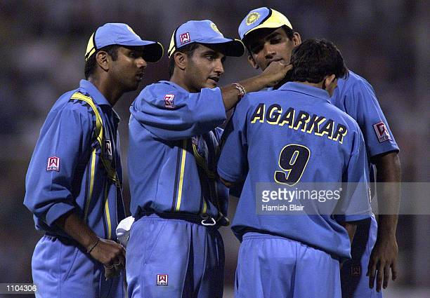 Rahul Dravid Saurav Ganguly and Zaheer Khan of India inspect the ear of team mate Ajit Agarkar during the first One Day International match between...