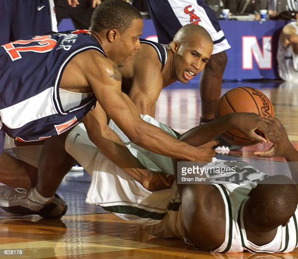 Richard Jefferson and Jason Gardner of Arizona battle Zach Randolph for the ball during the semifinal of the Men's NCAA Basketball Final Four...