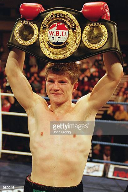 Ricky Hatton of England holds up the WBU LightWelterweight belt after defeating Canada's Tony Pep via a Round 4 knockout at Wembley Conference Centre...