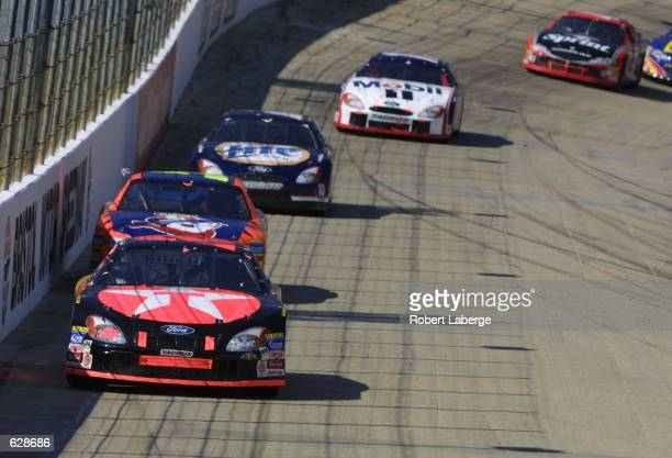 Ricky Rudd leads the pack in his Texaco Havoline Ford Taurus during the NASCAR Winston Cup Food City 500 at Bristol Motor Speedway in Bristol...