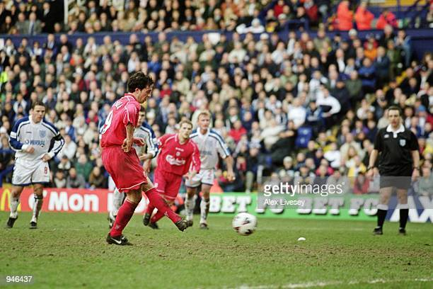 Robbie Fowler of Liverpool scores from the penalty spot to kill the game off during the AXA Sponsored FA Cup Quarter Finals match against Tranmere...
