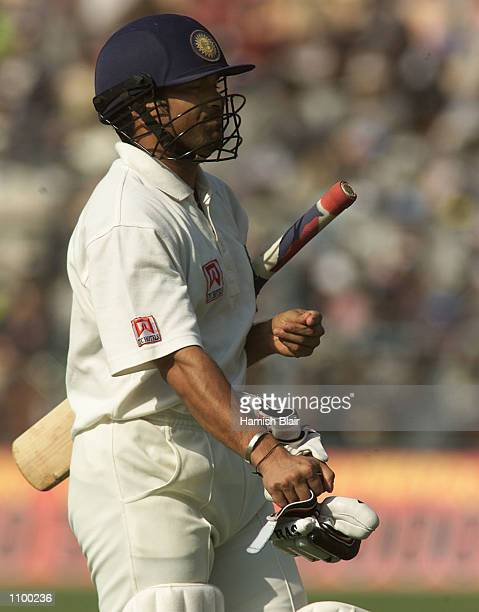 Sachin Tendulkar of India leaves the field after being trapped LBW to Glenn McGrath of Australia during day two of the 2nd Test between India and...