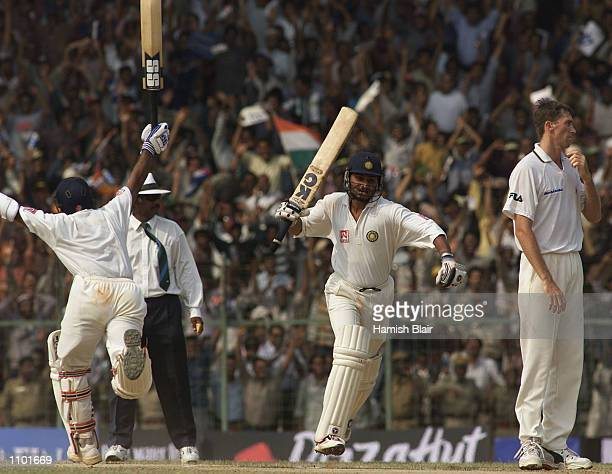 Sameer Dighe and Harbhajan Singh of India celebrate as they complete the winning runs as Glenn McGrath of Australia can''t hide his disappoinment...