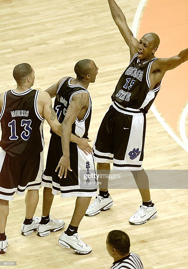 Sherard Long of the Georgia State Panthers celebrates his goahead shot with Kevin Morris and Darryl Cooper in a 5049 upset of the Wisconsin Badgers...