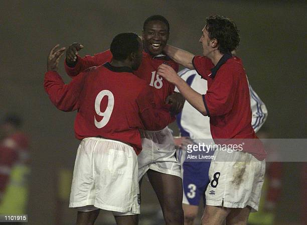 Shola Ameobi of England celebrates with Darius Vassell and Jonathan Greening after scoring the third goal during the England U21 v Finland U21...