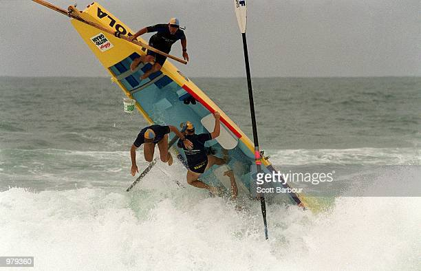 The Bilgola crew wipeout during the Surf Boat competition at the 2001 New South Wales Surf Life Saving Championships held at South Maroubra Beach...