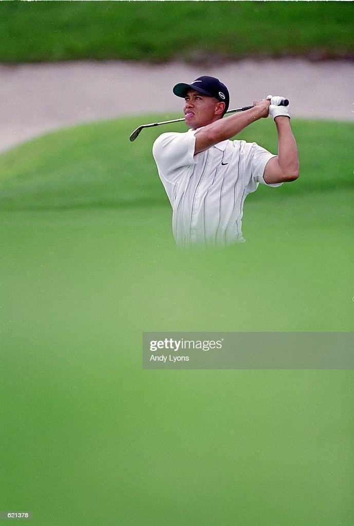 Tiger Woods follows his drive during the Bay Hill Invitational at Bay Hill Club and Lodge in Orlando, Florida.Mandatory Credit: Andy Lyons /Allsport