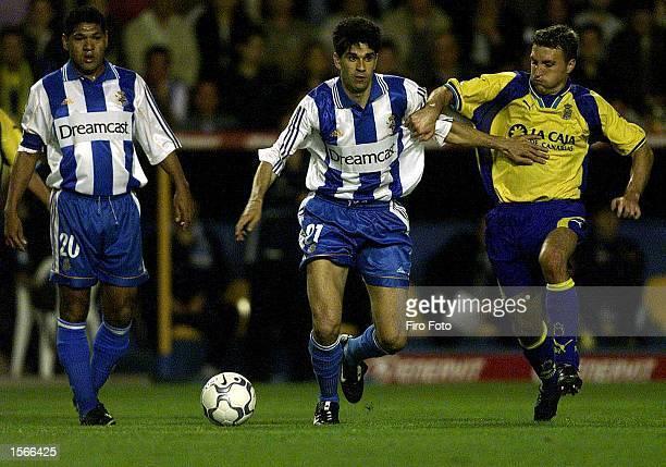 Valeron of Deportivo and Josico of Las Palmas tussle for the ball during the Primera Liga match played between Las Palmas and Deportivo La Coruna at...