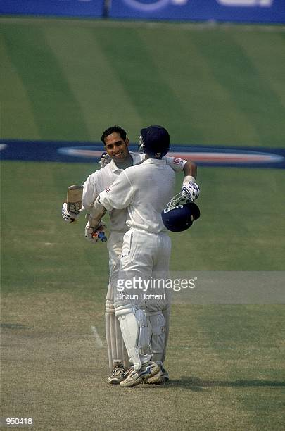 VVS Laxman of India is congratulated on reaching his double century by team mate Rahul Dravid during the Second Test match against Australia played...