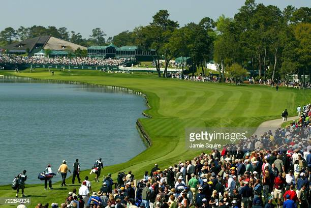 A general view of the 18th hole as Tiger Woods Hal Sutton and Fred Funk walk off the tee during Friday's second round of the Players Championship at...