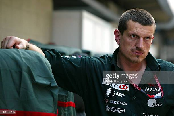 A thoughful Guenther Steiner of Jaguar watches the paddock during the FIA Formula One Brazilian Grand Prix at Interlagos Sao Paulo Brazil DIGITAL...