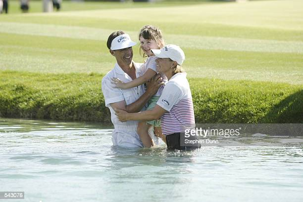 Annika Sorenstam brings her caddie Terry McNamara and his daughter Reilly into the pond after winning the Kraft Nabisco Championship at Mission Hills...