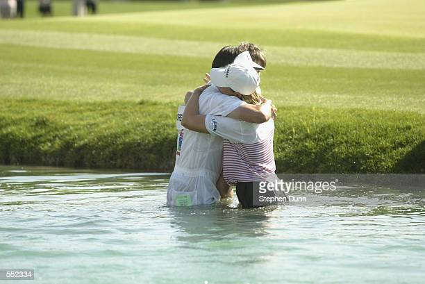 Annika Sorenstam hugs her caddie Terry McNamara in the pond after winning the Kraft Nabisco Championship at Mission Hills Country Club in Rancho...