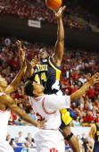 Antonio Gates of the Kent State Golden Eagles shoots over A J Moye of the Indiana Hoosiers in the second half of the Championship of the South Region...