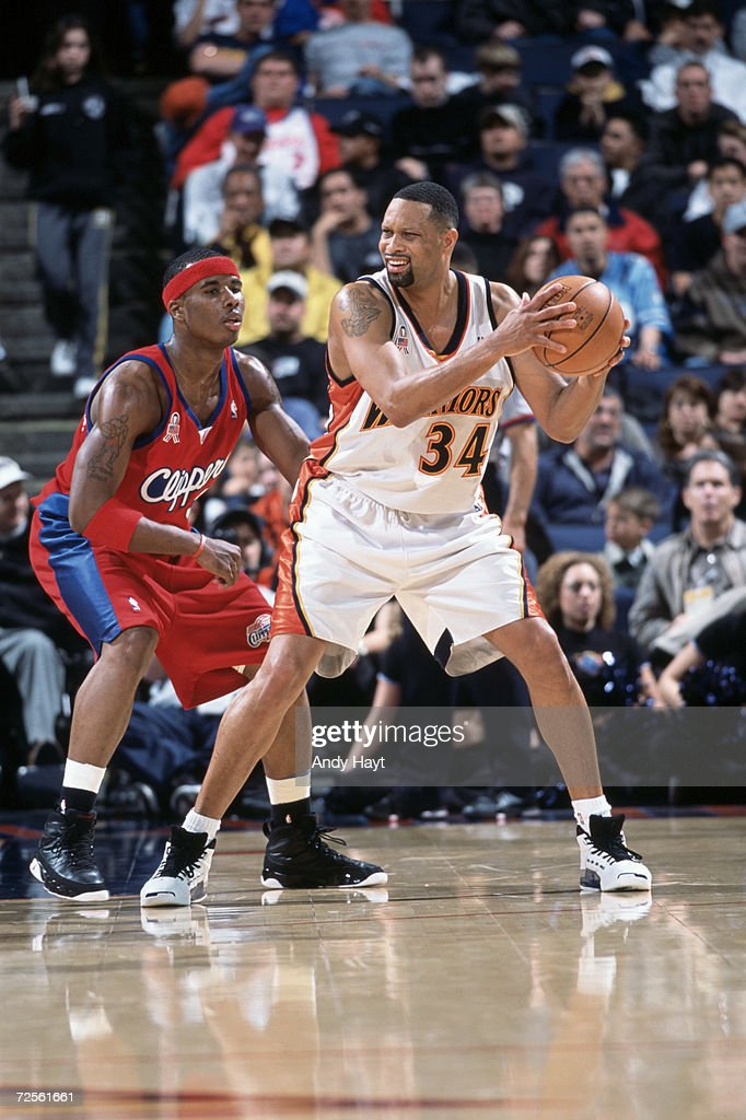 Chris Mills of the Golden State Warriors looks to move the ball as he is guarded by Quentin Richardson of the Los Angeles Clippers at The Arena in...