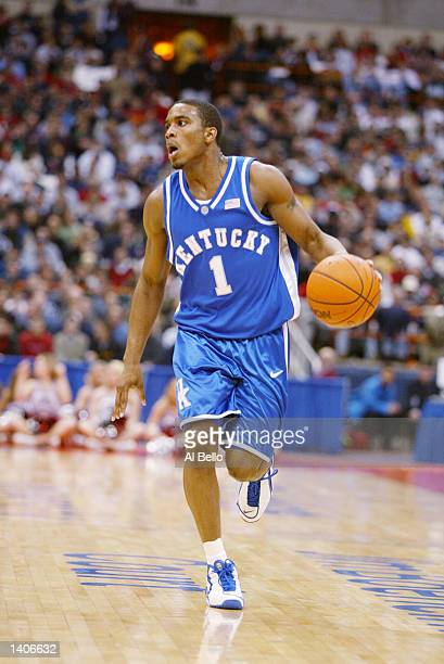 Cliff Hawkins of Kentucky dribbles against the defense of Maryland during the East Regional Semi Final at the Carrier Dome in Syracuse New York...