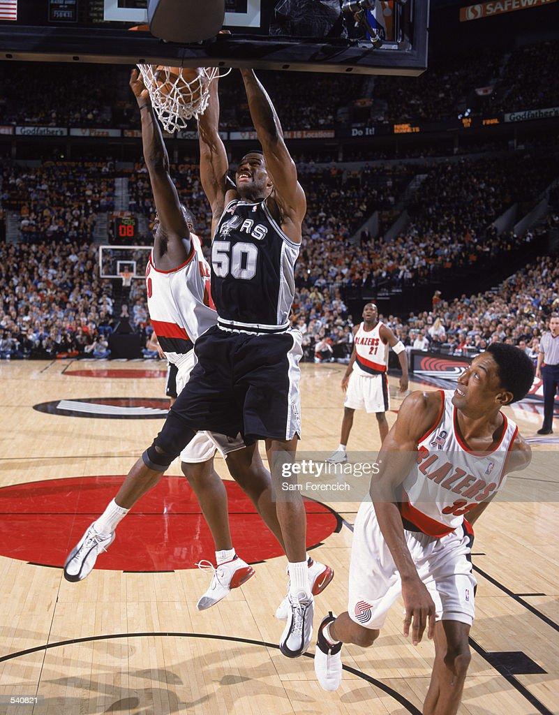 David Robinson makes a dunk