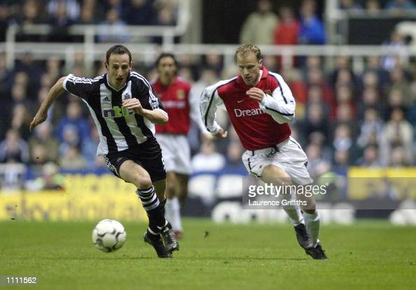 Dennis Bergkamp of Arsenal looks to go past Andy O''Brien of Newcastle United during the FA Barclaycard Premiership match played at St James Park in...